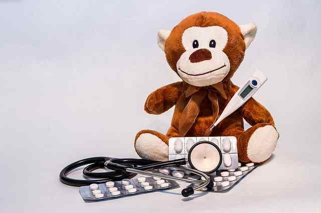 Peluche de mono con termómetro